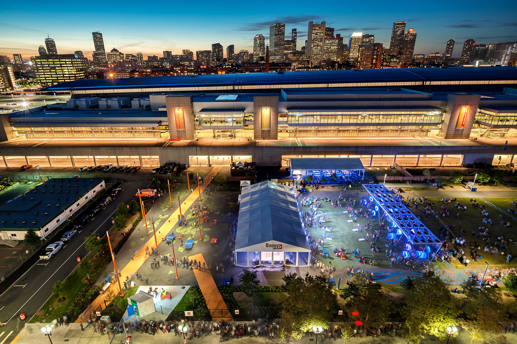 Night photo of looking at the Lawn on D and the convention center back to downtown Boston