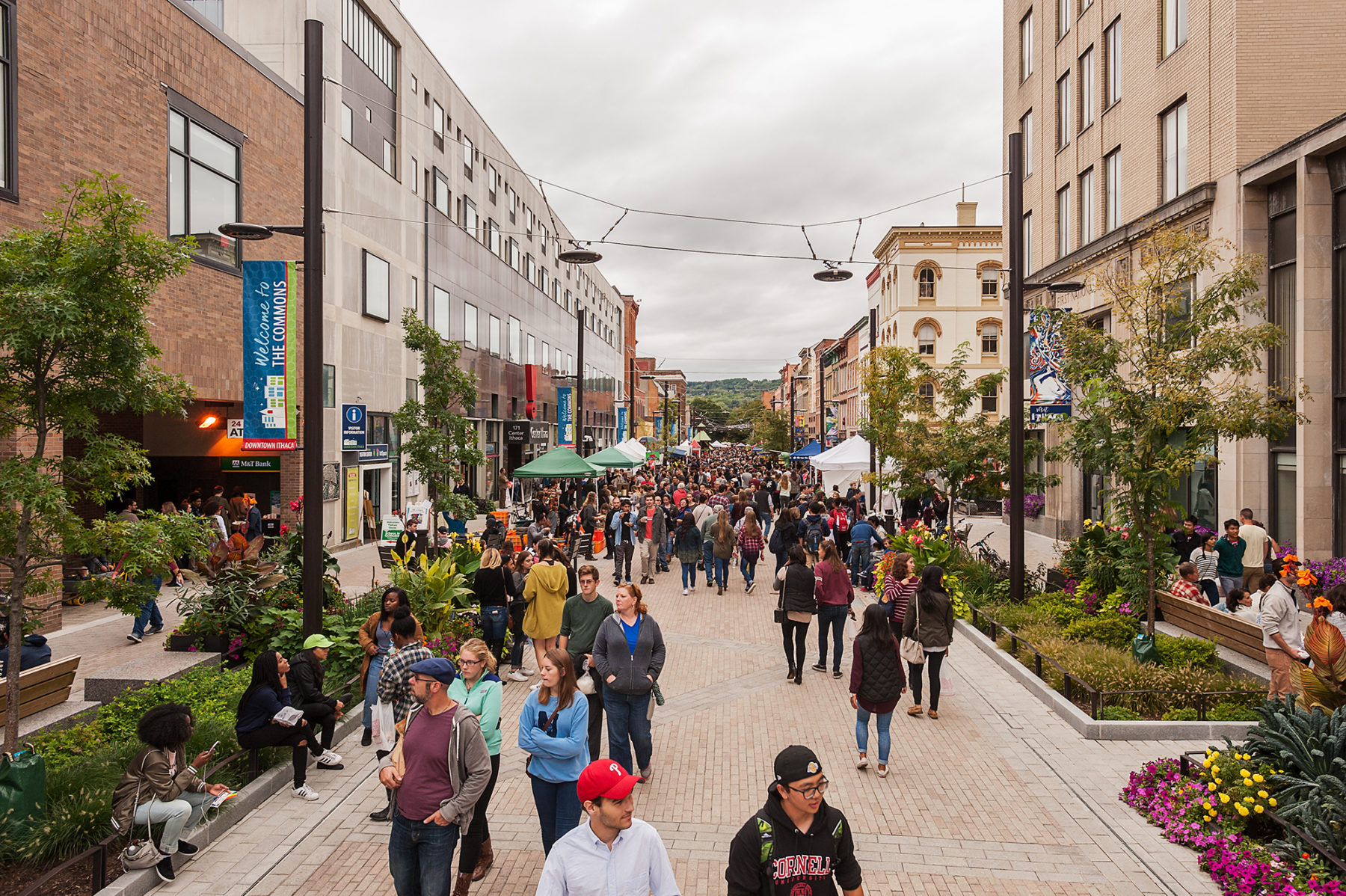 Crowd walks up the main strip of the pedestrian mall