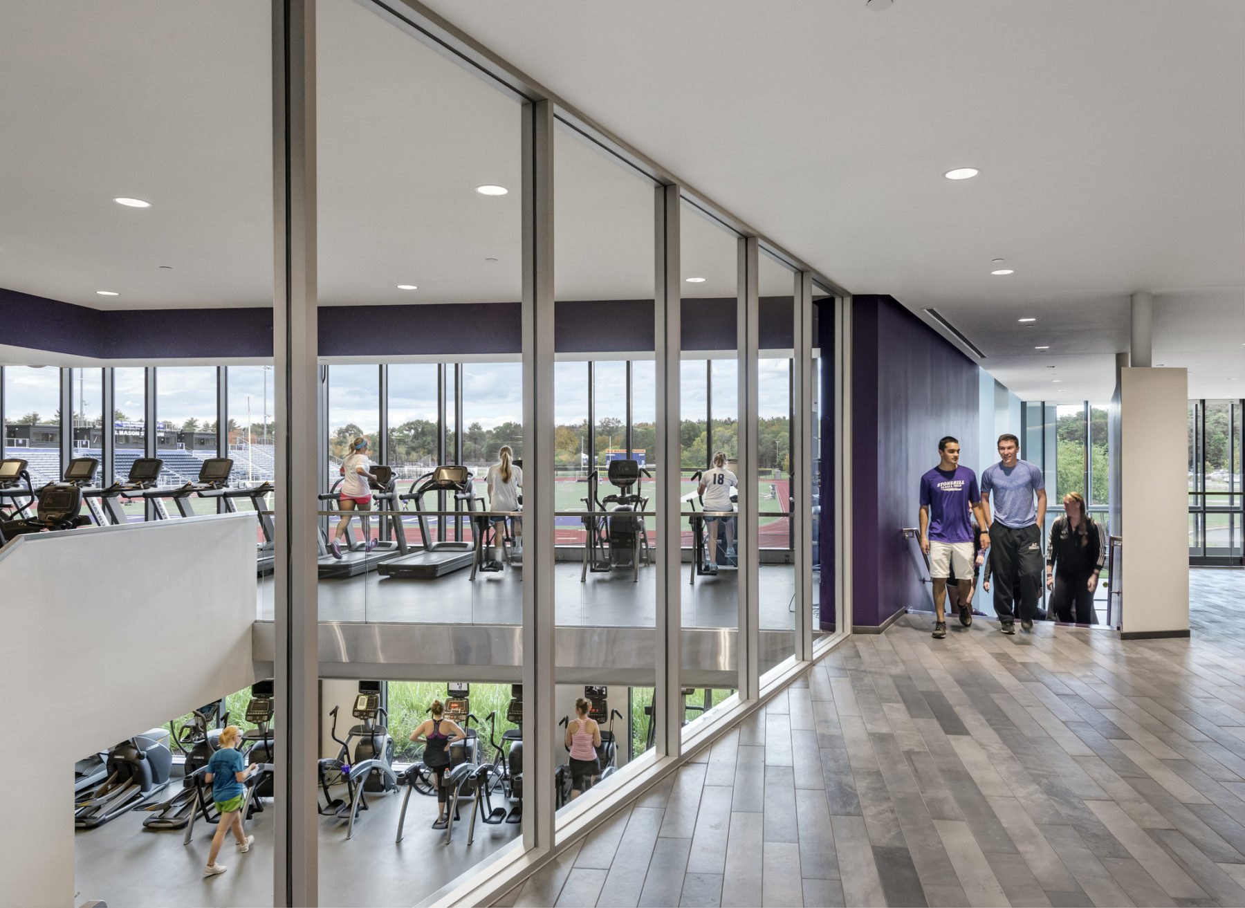 glass walls look onto cardio equipment