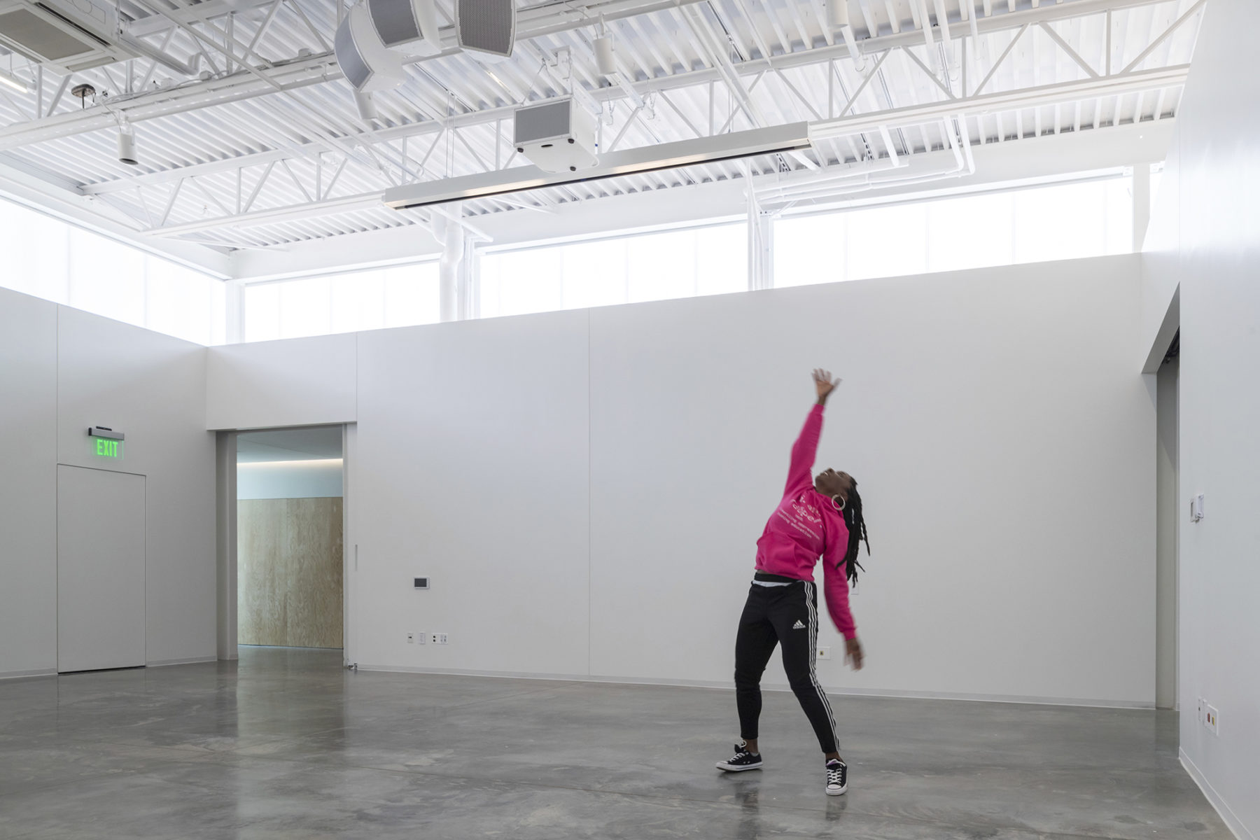 A performer showcases her talent in one of the gallery spaces