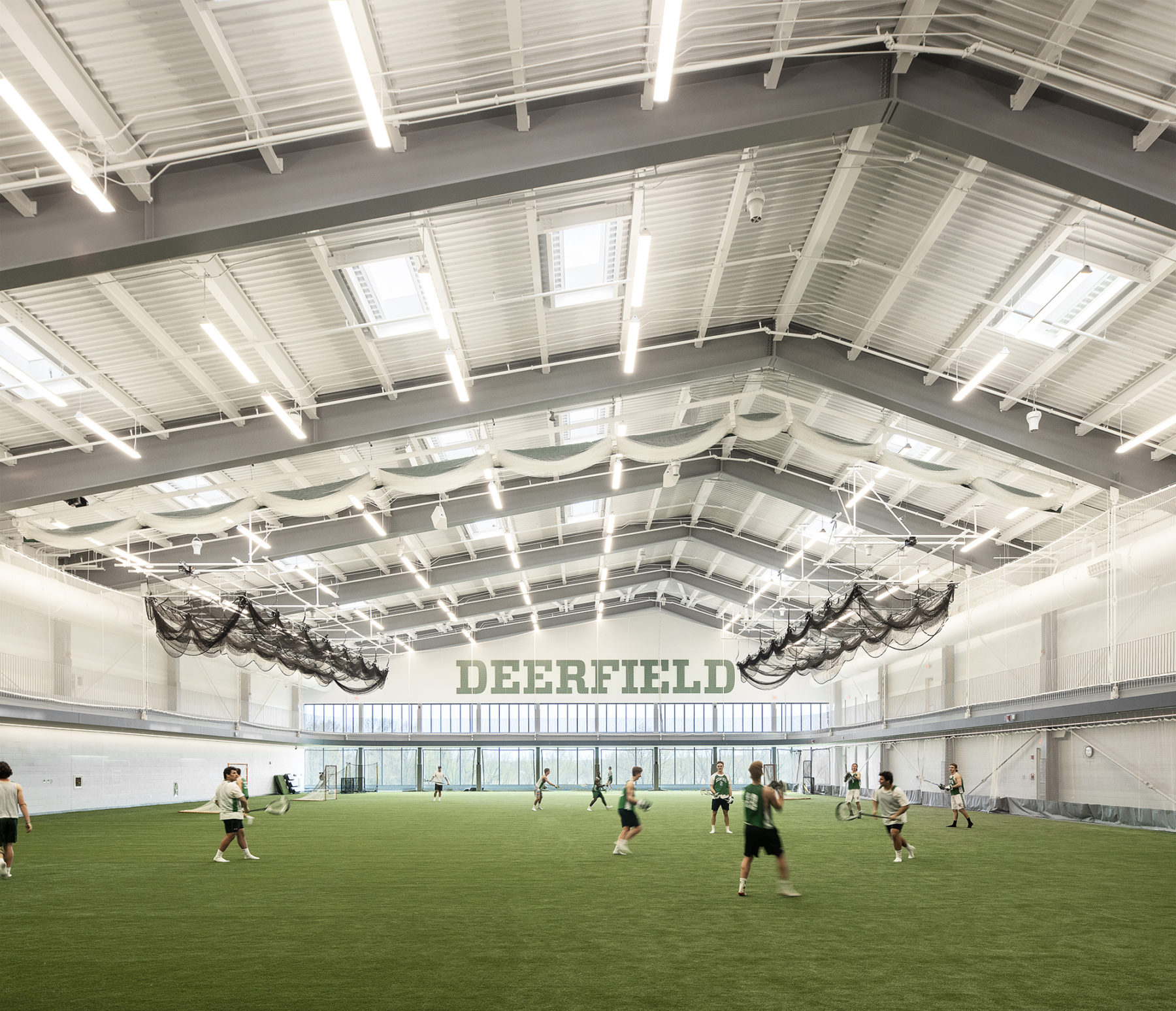 inside view of field house, students playing lacrosse