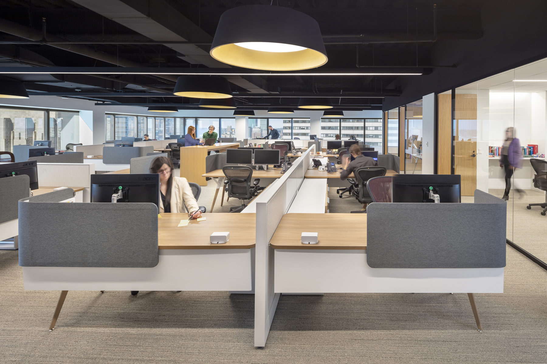 people sitting at desks in an open office