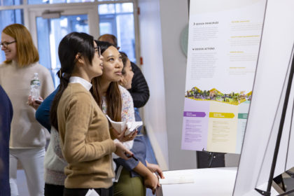 Two people looking at a presentation board